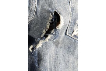 Repair rip in women's jeans